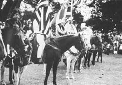 1983 Grand Finale with sonny Miranda(foreground), Anna on white horse with the late Richard Lindsey holding the Hawaiian flag.